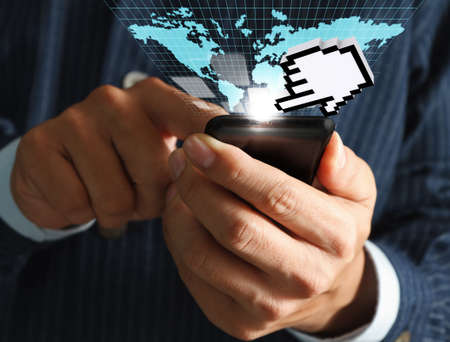 world thinking: business man hand use mobile phone streaming virtual business world and hand cursor