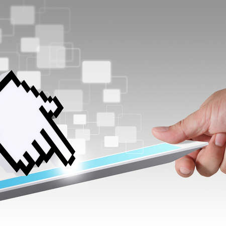 close up of hand holds tablet computer and hand cursor and virtual button photo