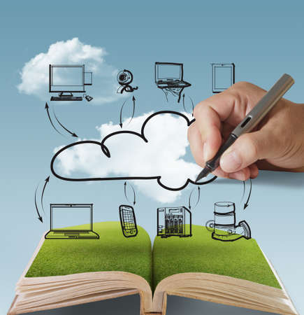 wall clouds: open book of businessman drawing cloud network Stock Photo