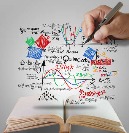 physic: open book of hand draw well-known physical formula Stock Photo