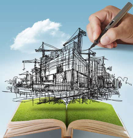construction project: open book of hand draws building and construction Stock Photo