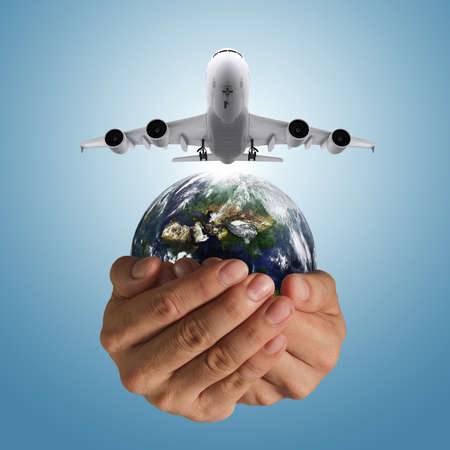 hand holds airbus plane and globe as concept, elements of this image furnished by NASA photo