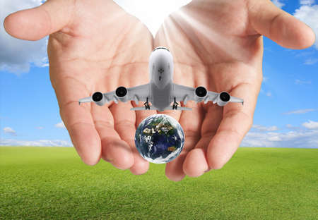 hands in the air: hand holds airbus plane and globe as concept,elements of this image furnished by NASA