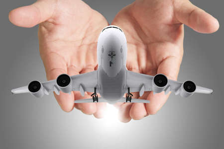 passenger aircraft: airbus plane in hands as concept