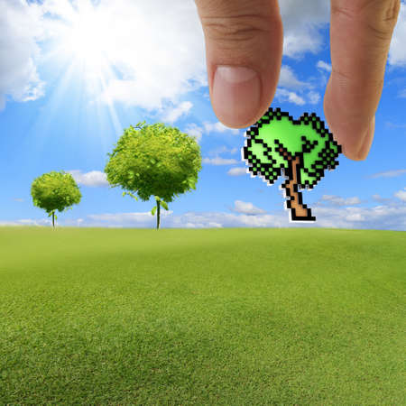 close up of hand picks pixel tree icon as concept photo