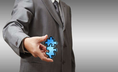 business man hand shows pixel puzzles icon as partnership concept Stock Photo - 13652450