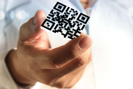 close up of business hand shows 3d Qr code as concept