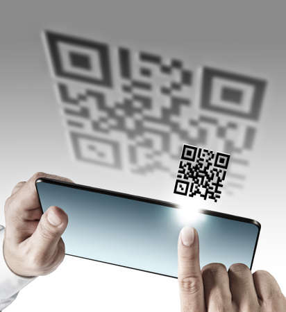close up of business hand use tablet computer with Qr code scan as concept photo