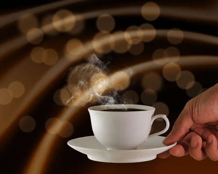 attar: hand holds a cup of hot coffee