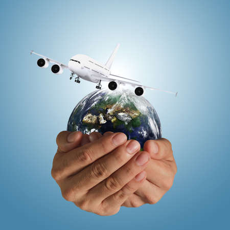 air cargo: hand holds airbus plane and globe as concept, elements of this image furnished by NASA