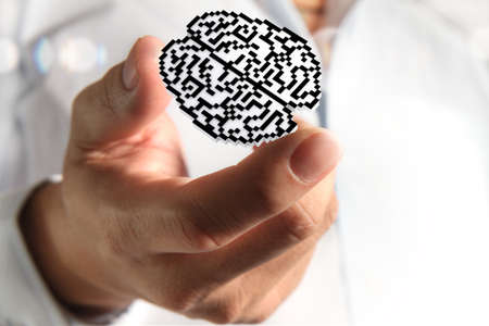 medical student: business man hand show brain pixel icon sign as medical technology