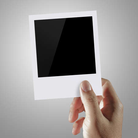 man hand holding two blank photo frame Stock Photo - 13770549