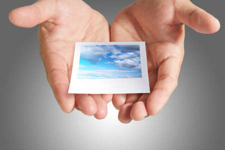 cloud instant photo in hand Stock Photo - 13770573