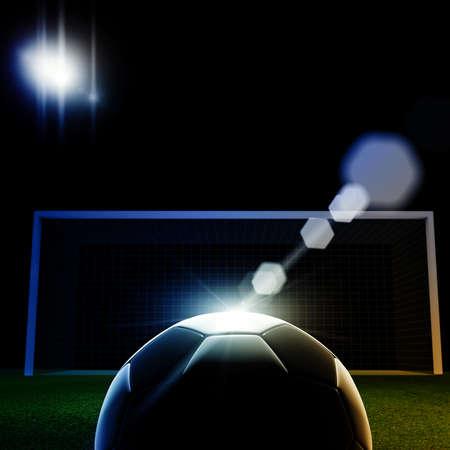 field goal: Soccer ball on grass against black background