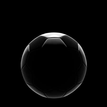 Soccer ball on grass against black background photo