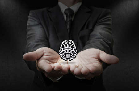 business man hand shows pixel brain icon as concept photo