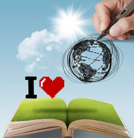 protection of land: open book of hand drawn I LOVE THE EARTH Stock Photo