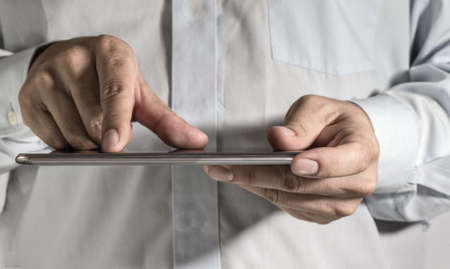 close up of business man hand working on a digital tablet Stock Photo - 13973650