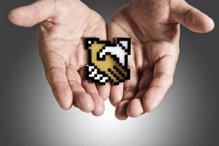 close up of business hand shows pixel handshake icon sign photo