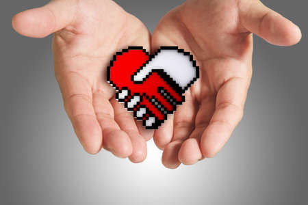 hand shows hand shake, heart shaped symbol as medical technology,clipping path Stock Photo - 13973684