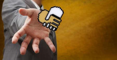 business man hand reach pixel handshake heart sign as concept Stock Photo - 14136176
