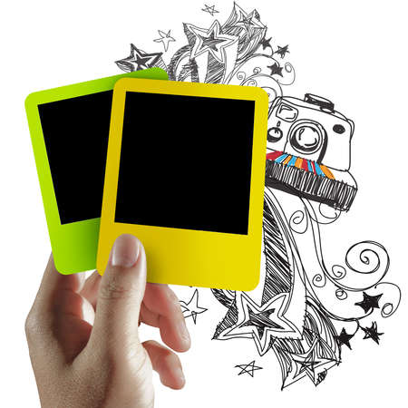 hand hold blank colorful photo frame and doodle background photo