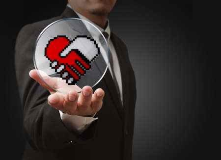 business man hand show pixel hand shake heart shaped symbol as medical technology concept