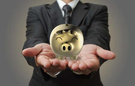 bank deposit: Businessman shows a piggy bank