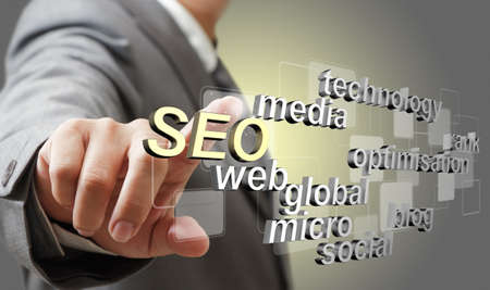 optimized: business man hand touch 3d SEO search engine optimization as concept Stock Photo