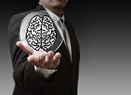 business man hand show 3d brain sign as medical technology