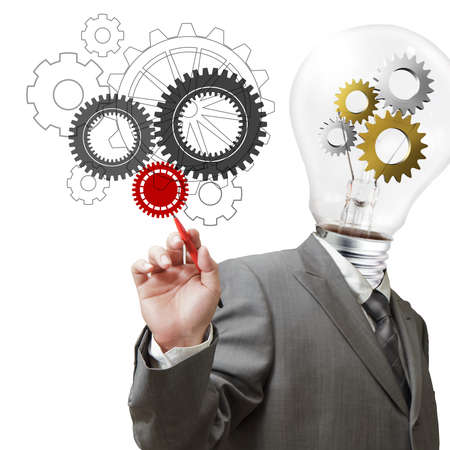 businessman light bulb head and cogs draws gears as concept