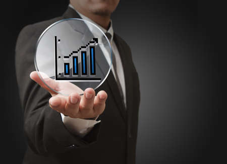 businessman hand shows pixel graph,chart icon and glass shield as concept Stock Photo - 14161672