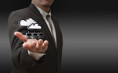 wall clouds: business man hand shows 3d pixel cloud network icon as concept