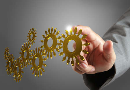 businessman hand and gold people cogs as concept photo