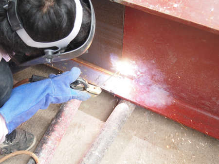 welding with mig-mag method on metal beam photo
