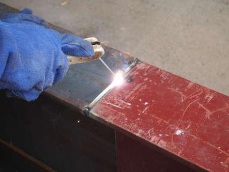 welding with mig-mag method on metal beam photo