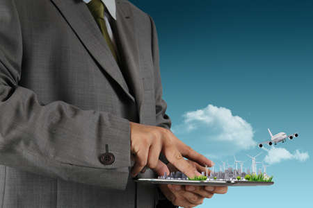 businessman hand holds touch pad as concept photo