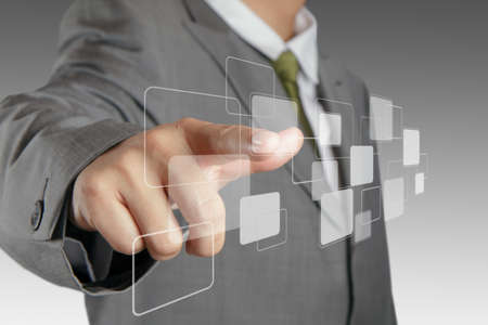 business man hand pushing on a virtual touch screen interface Stock Photo - 14444919
