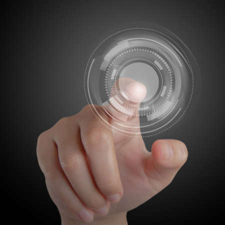 touch screen interface: Hand and Touchscreen Technology as concept Stock Photo