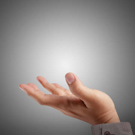Empty open hand on dark Stock Photo - 14530087