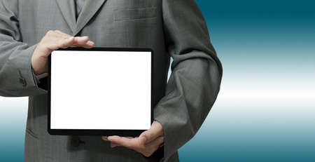 businessman hand holds and touch tablet computer isolated on white background photo