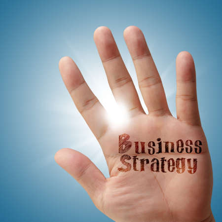 Business strategy on his hand as concept photo