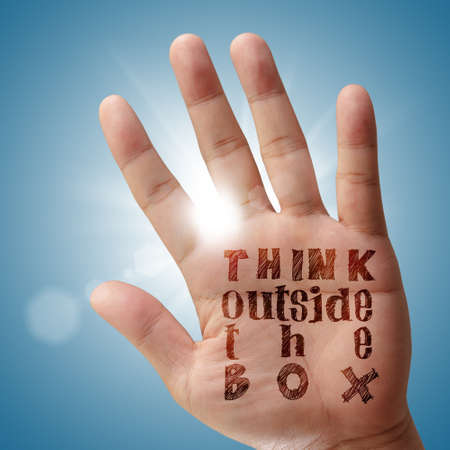 innovation word: hand shows concept of think outside the box
