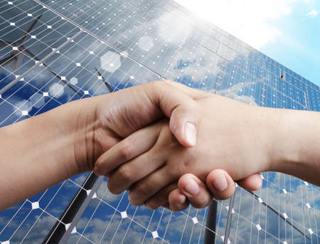 partnership power: handshake and sunlight background Stock Photo