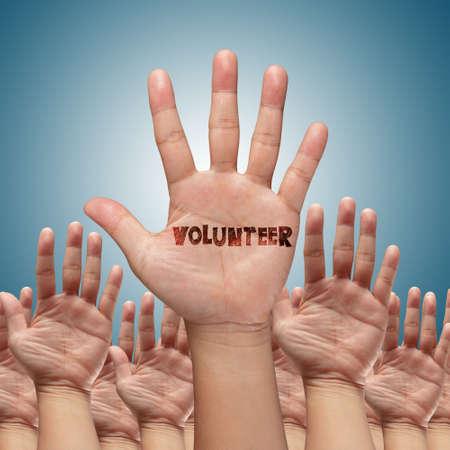 volunteer group raising hands against blue sky background Stock Photo - 14731761