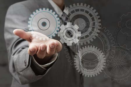 hand shows cogwheels as concept Stock Photo - 14774933