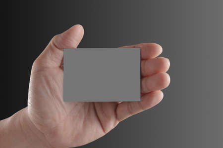 Businessman's hand holding blank paper business card Stock Photo - 14774877