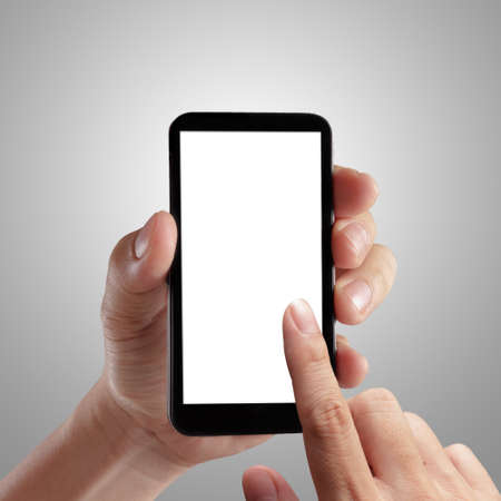 Hand holding mobile smart phone with blank screen. Isolated on white. photo