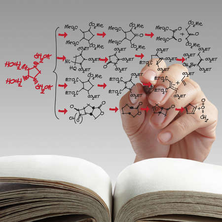 chemistry science: hand drawing molecule structure on white background