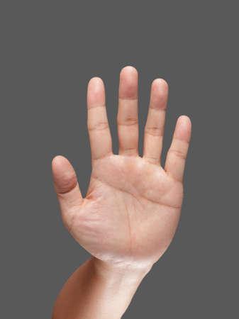 symbole de la main sur fond sombre